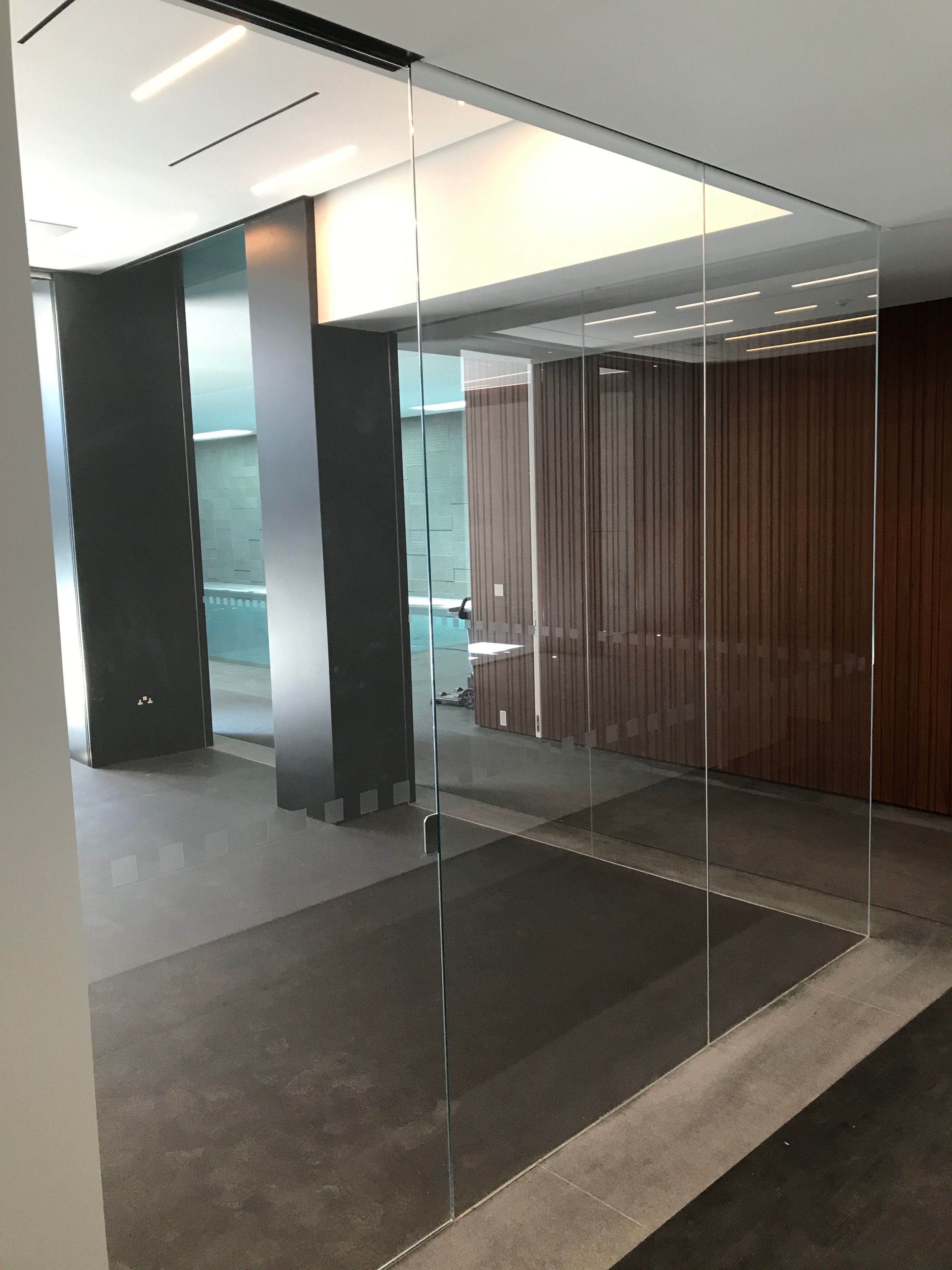 Frameless glass gym area partitioning, low-iron glass slotted into ...