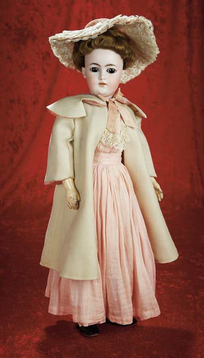 """German Bisque Lady Doll with Original Costume by Simon and Halbig    20"""" (51 cm.) Bisque socket head,brown glass sleep eyes,painted lower lashes,brush-stroked brows,accented nostrils,open mouth,four porcelain teeth,pierced ears,brunette mohair wig in original upswept coiffure,composition and wooden ball-jointed lady body with shapely bosom and derriere,elongated limbs. Condition: generally excellent. Marks: 1159 S dep 7 Germany"""