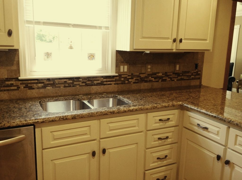 Tan brown granite white cabinets giallo vicenza granite Tan kitchen backsplash