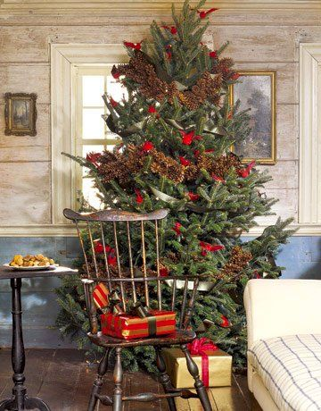 rustic christmas tree with pine cone garlands and red cardinal birds - Christmas Tree With Pine Cones