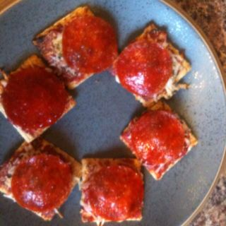 Little pizza snacks.   Triscuits  Tomato sauce  Pizza seasoning  Garlic powder  Shredded 4 cheese  Pepperoni