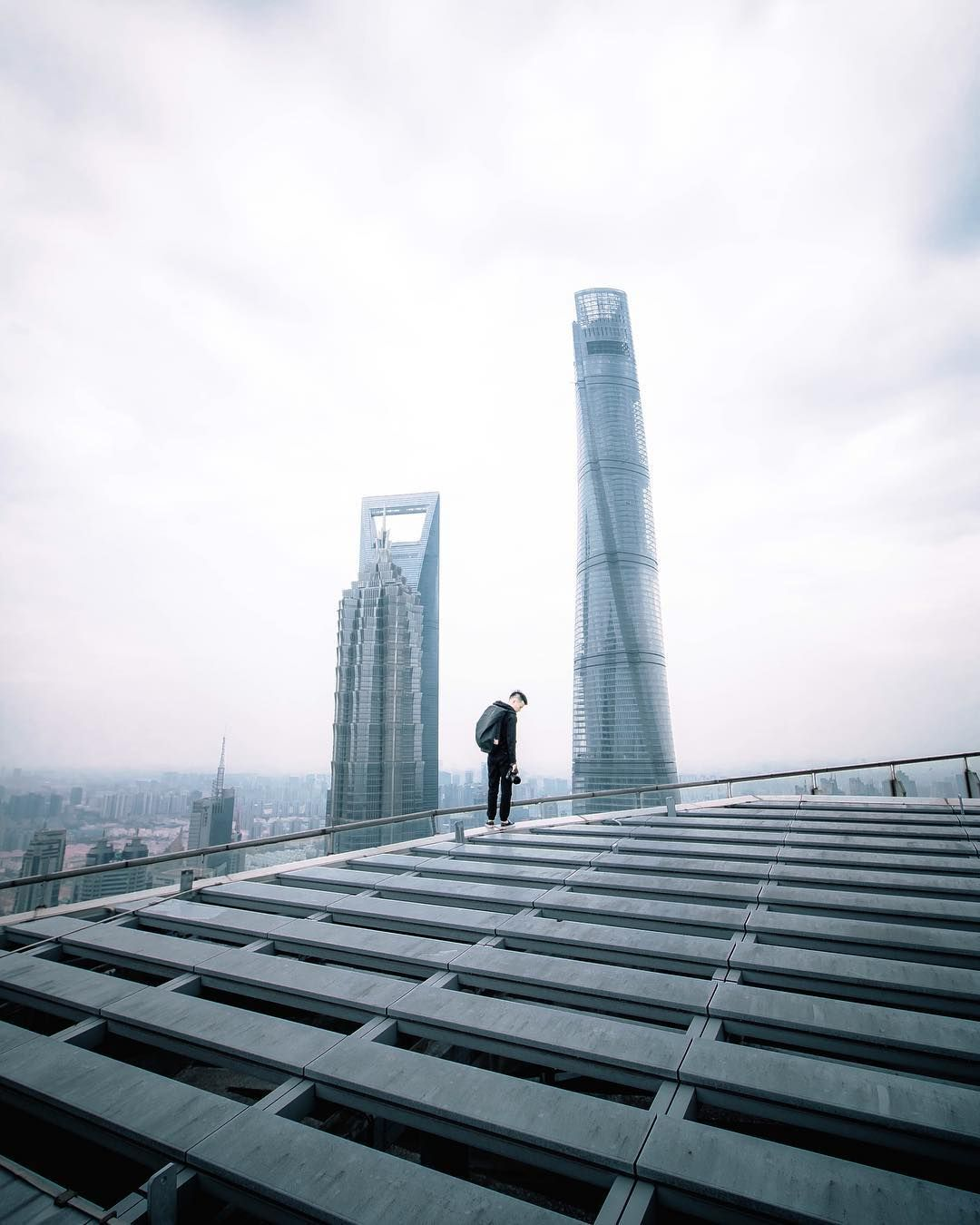Breathtaking Rooftop Shots From Skyscrapers Of Shanghai By Anselm - Epic photos taken from the rooftops offer a new perspective of london
