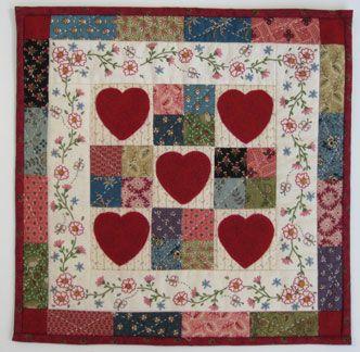 Hearts quilt. Stitchery border surrounding the centre