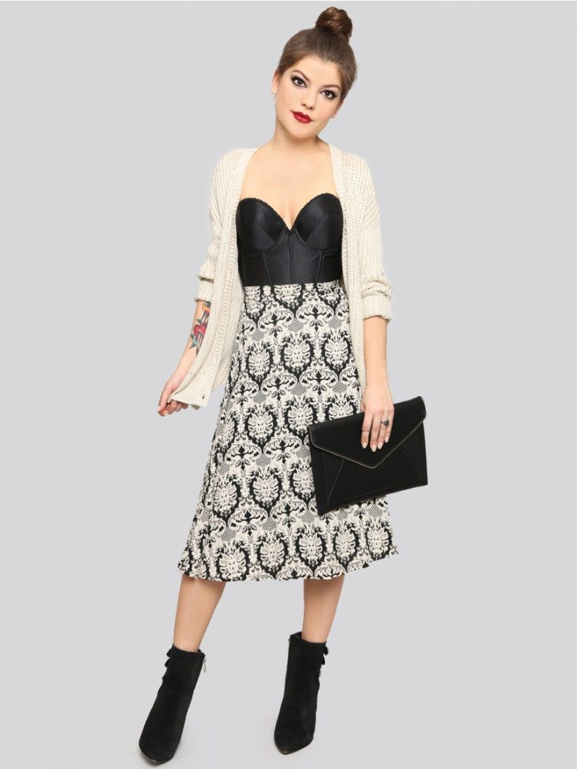 Flowy midi skirt featuring a zipper closure fitted waist and