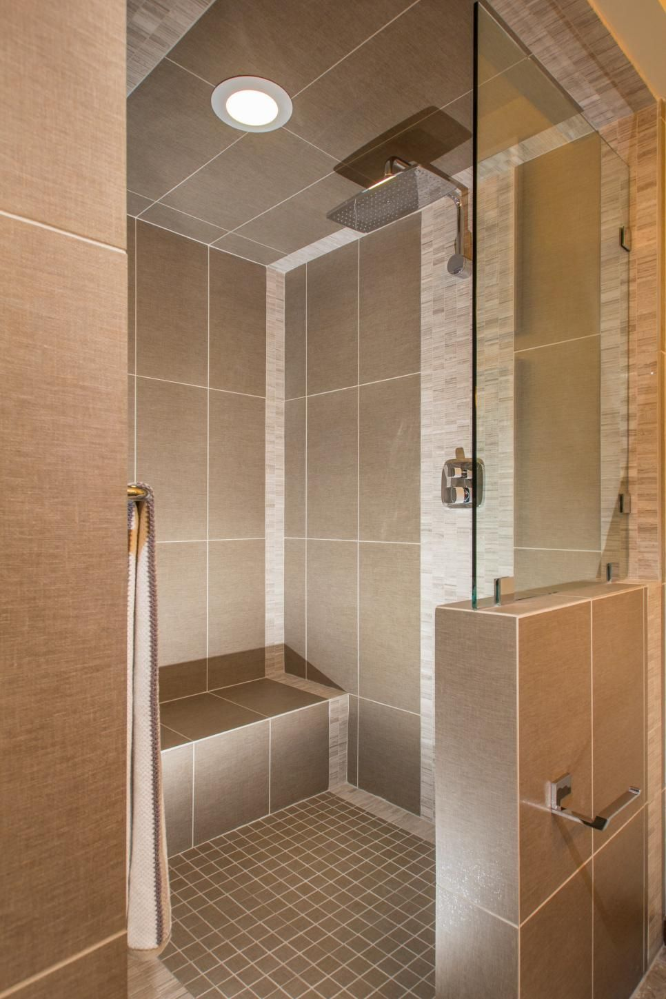 Large Textured Tiles Mix With Smaller Mosaic To Give This Walk In Shower A Geometric Kick Rainforest Head Adds Touch Of Luxury