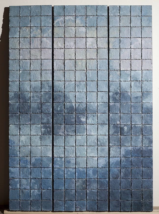 Blue Mist by Elizabeth MacDonald. Tile painting made of ceramic powders layered on thin pieces of textured clay, torn into tiny squares and assembled.