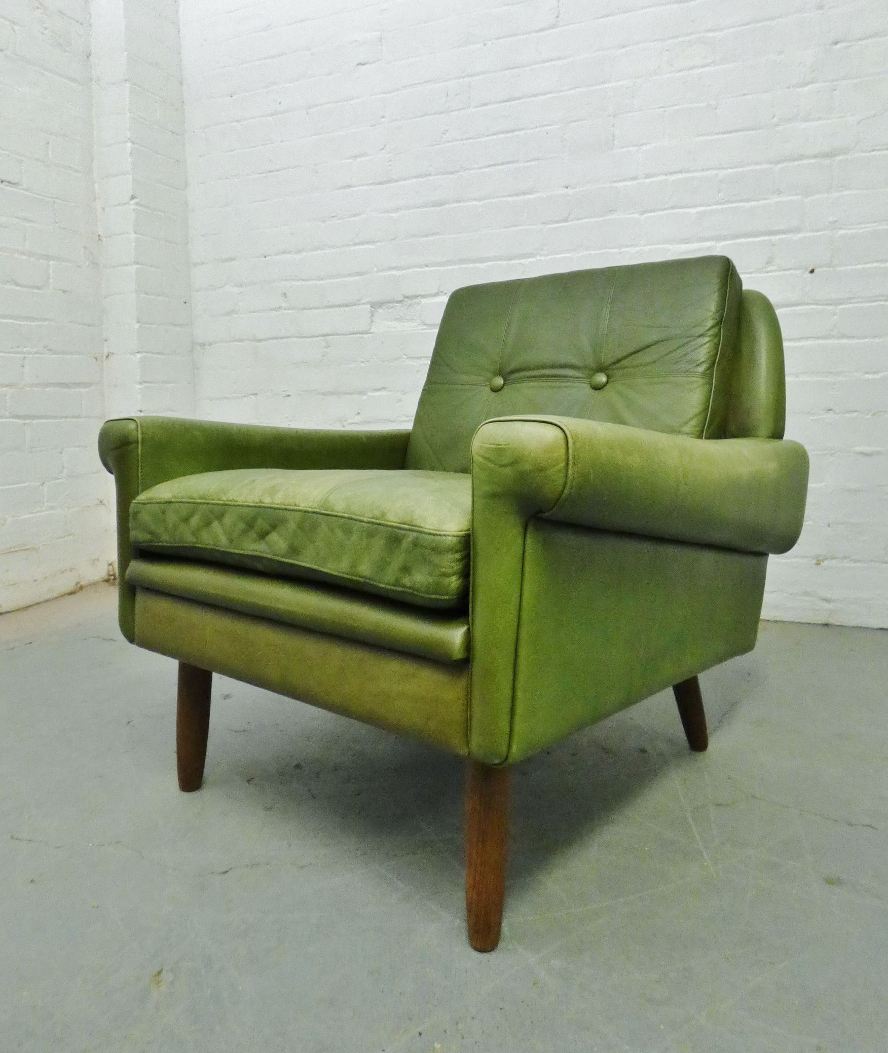 1960s green leather armchair by Skipper Furniture www