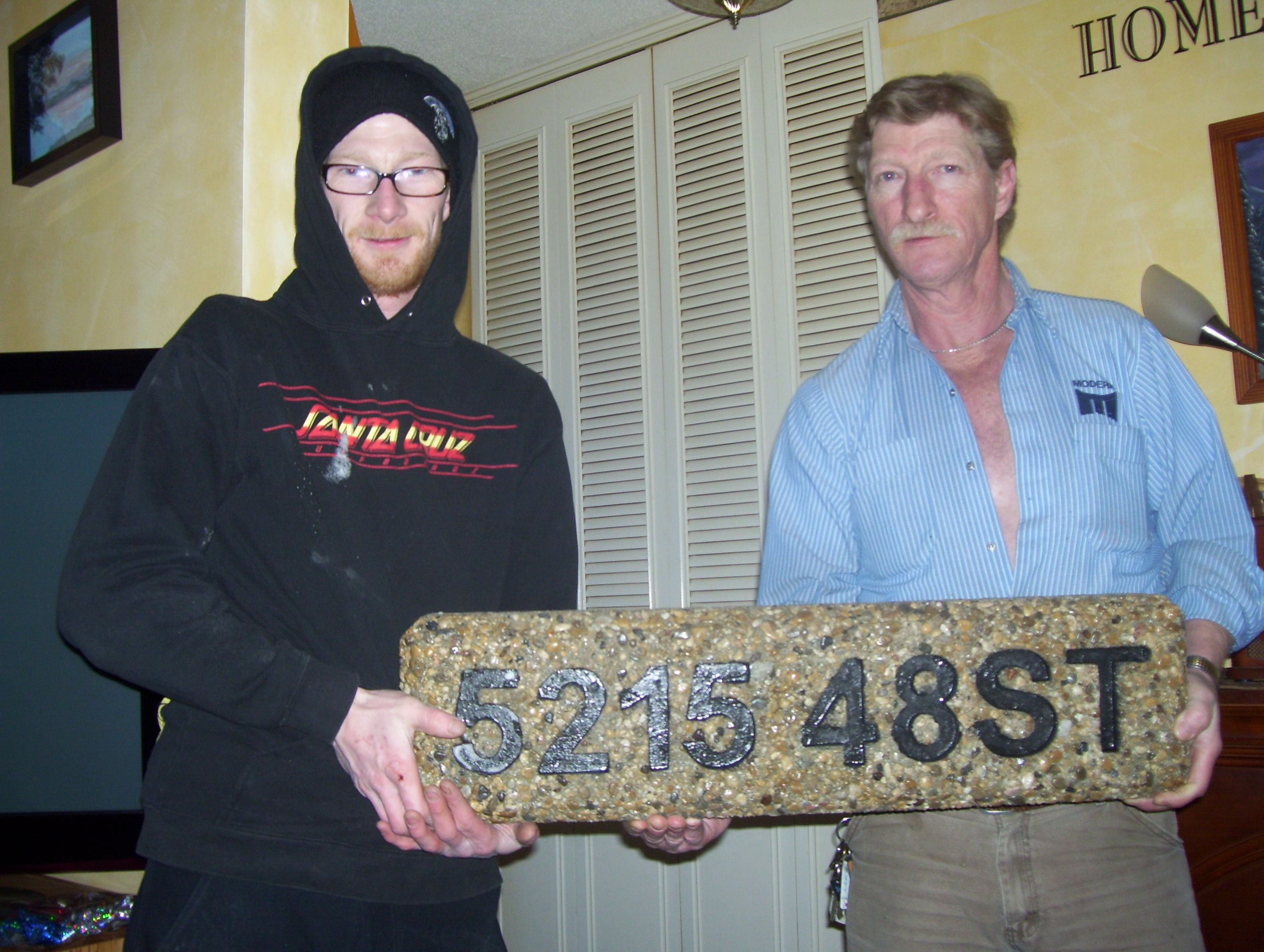 An address Sign Brent our son made from cement and rock at NAIT