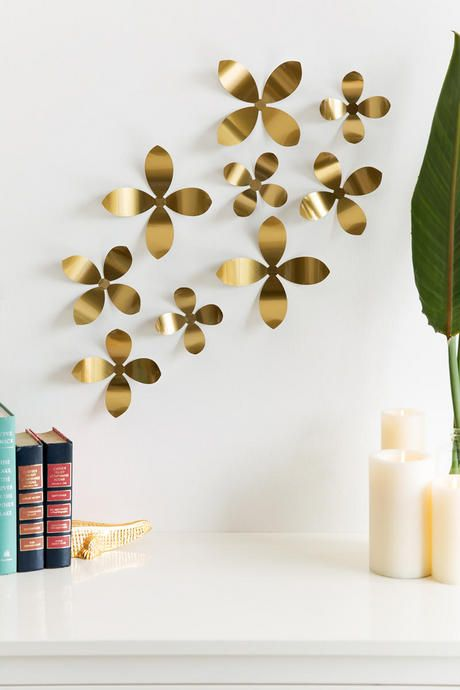 Add some metallic art to any room with the Gold Metal Wall Flowers ...