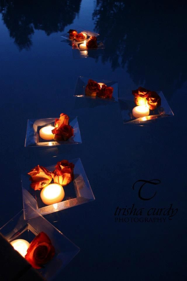 pool decor floating trays with roses and candles | Weddings we have ...
