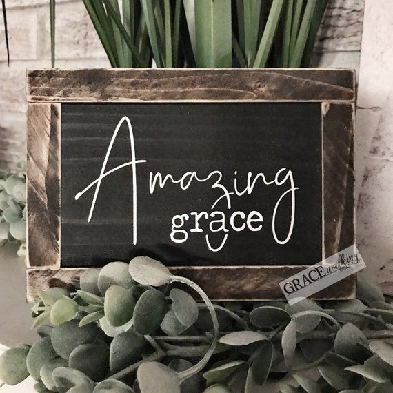 READY TO SHIP ~ Amazing Grace Rustic Wood Sign   Farmhouse Sign   Inspirational Sign   Christian Decor   Chris is part of Dorm decor Signs - Ships in 13 business days  This sign is handpainted, stained, distressed and ready to sit on a table or shelf   This sign measures approx 7in x5in  Black Background White Lettering No hanging hardware is included
