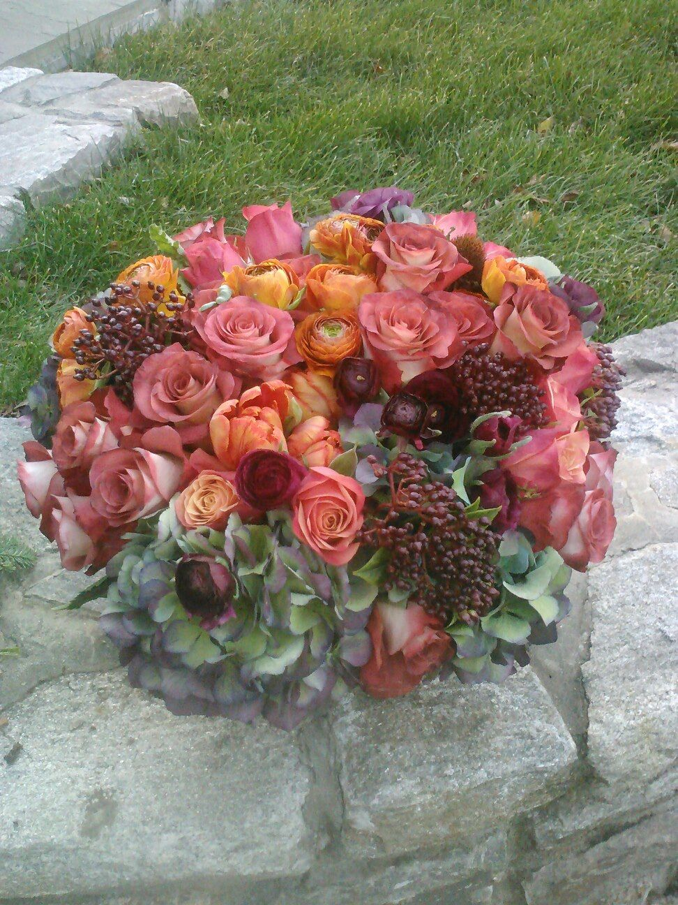 Ranunculus, Roses, Hydrangeas and berries.  Created By Sarah Saunders
