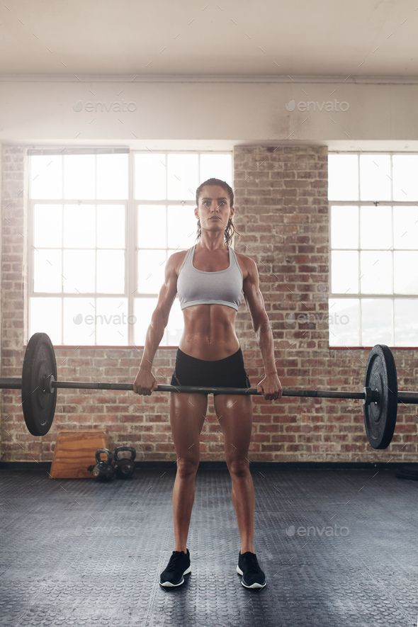 Fit young female athlete lifting heavy weights by jacoblund. Fit young female athlete lifting heavy weights. Fitness model performing crossfit exercise at gym.#lifting, #heavy, #weights, #athlete