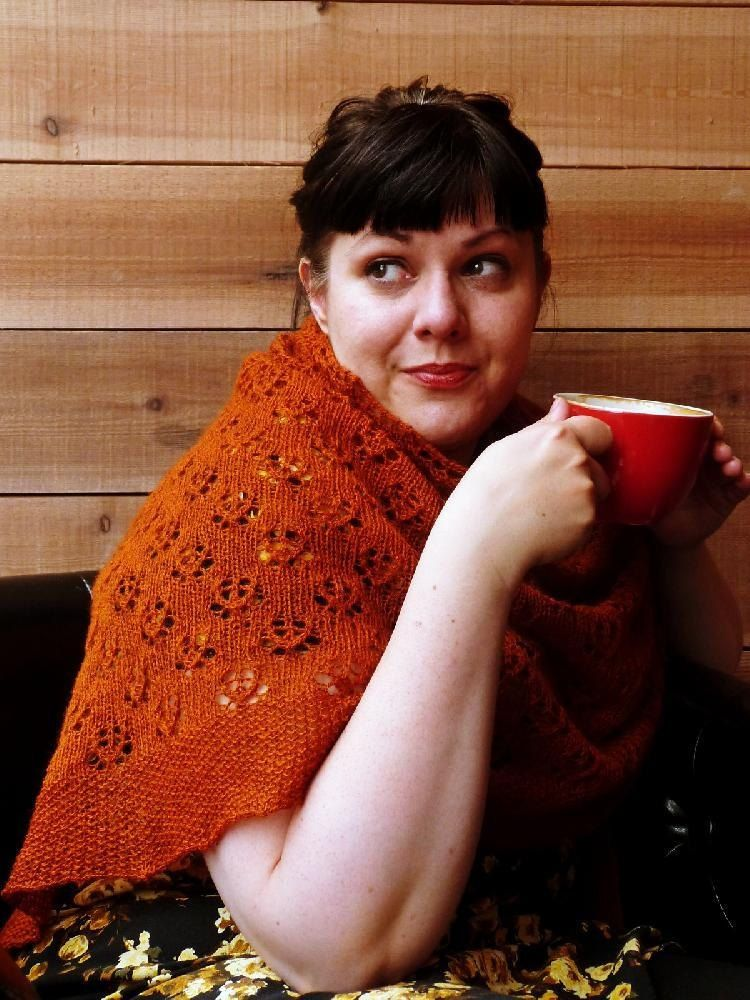 Fika is alarge triangular shawl is named after the Swedish custom - you take a moment out of your busy life to slow down over a cup of coffee and spend some time catching your breath - find the beautiful knitting pattern in orange on LoveKnitting!