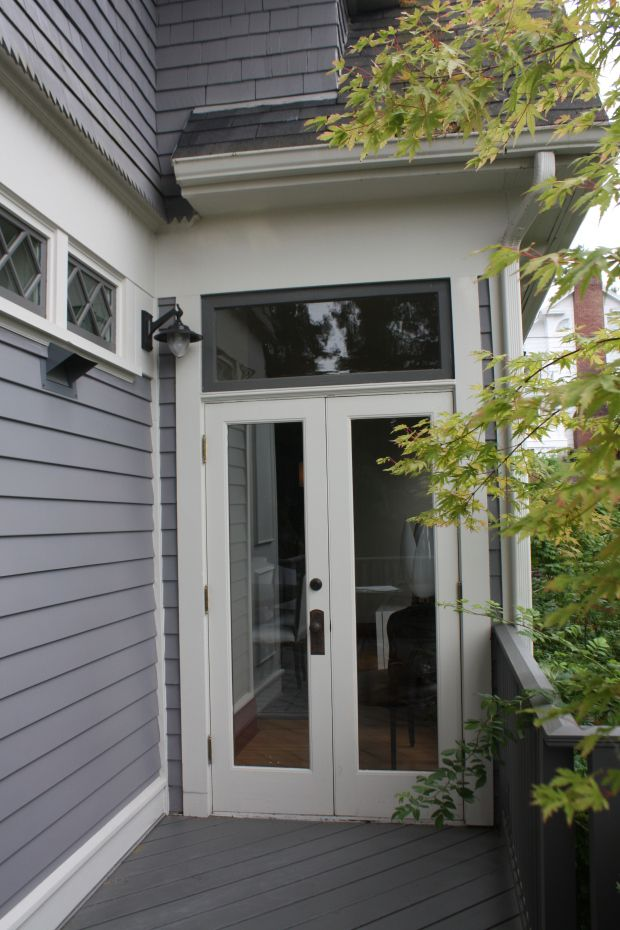 Tall narrow french doors with a transom overhead  Windows