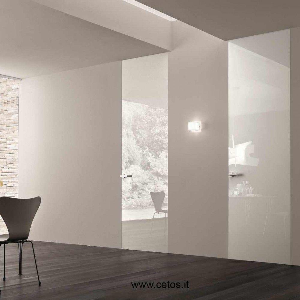 Porta filomuro bianca su pavimento legno interior design pinterest legno porte interne e filo - Porta a filo muro prezzi ...