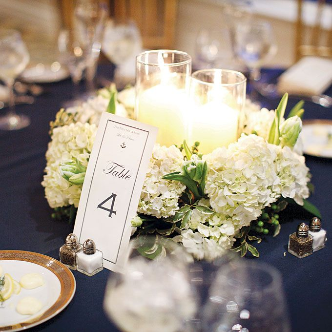 Brides white hydrangea and candle centerpiece inside the