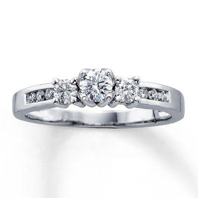 14K White Gold 1/2 Carat t.w. Three-Stone Diamond Ring - looks to be a bit high setting, but...
