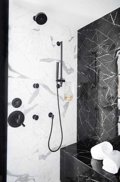 Black Marble Herringbone Pattern Shower Wall Tiles Complement A Black Marble Bench And Contrast Whit Marble Shower Walls Black Marble Bathroom Shower Wall Tile