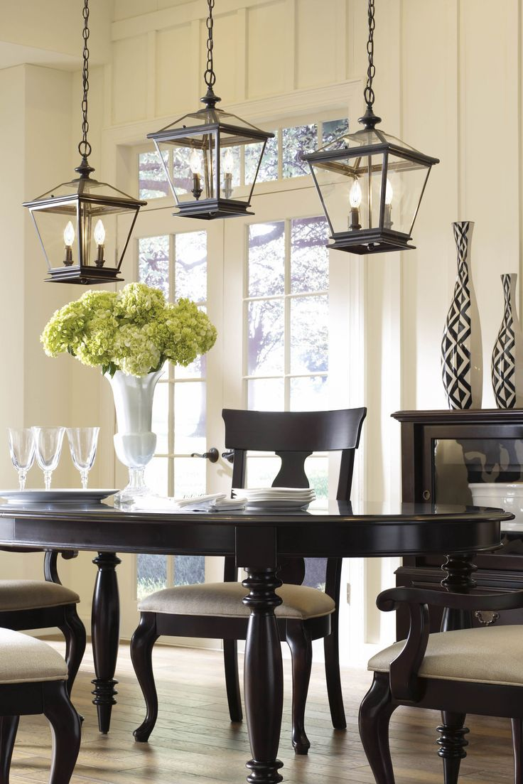 Grouped Lanterns Above A Dining Room Table Add Contemporary Flair To Your Traditional Home
