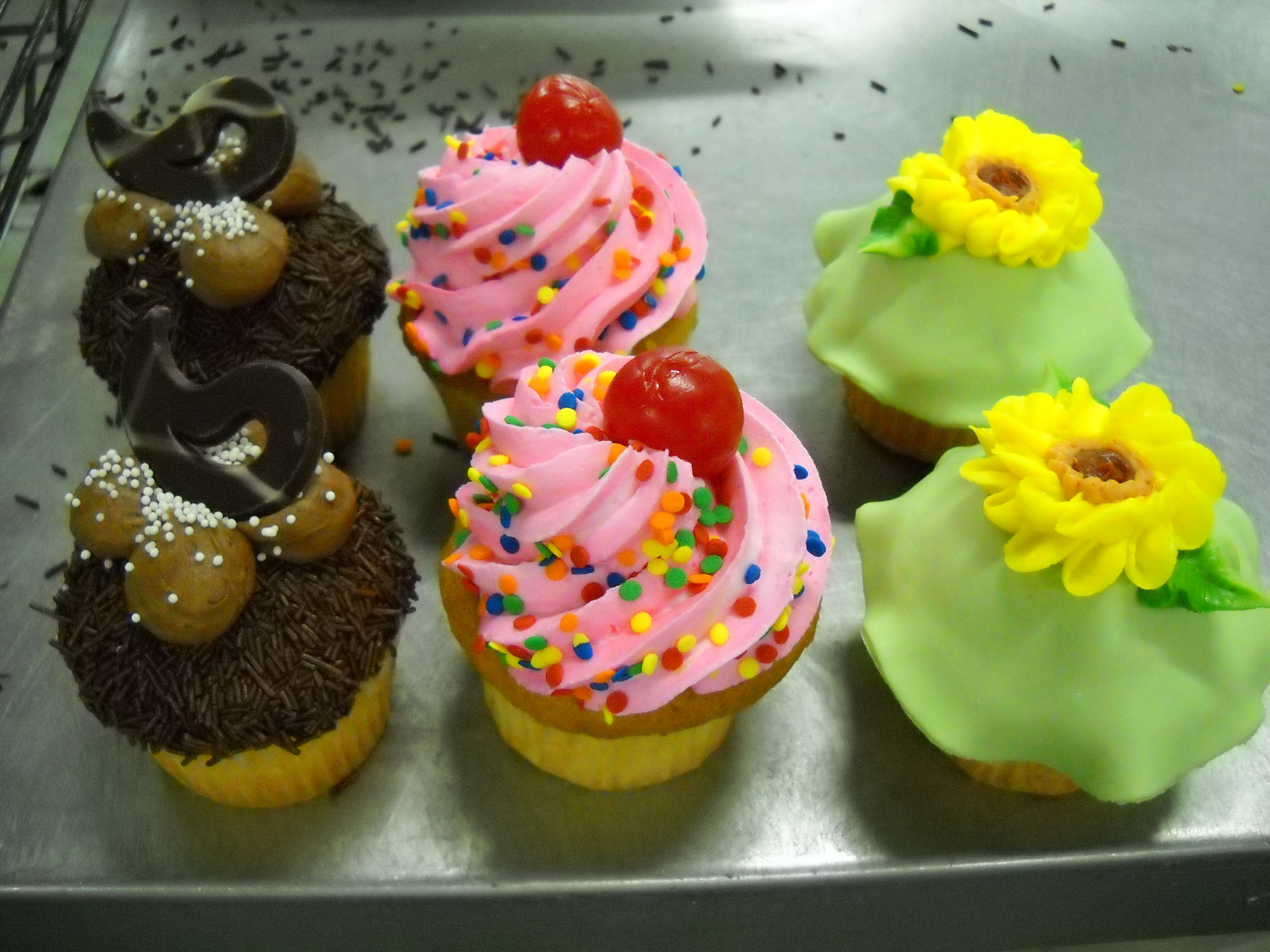 Adorable Cupcakes! One even has a cherry on top!11