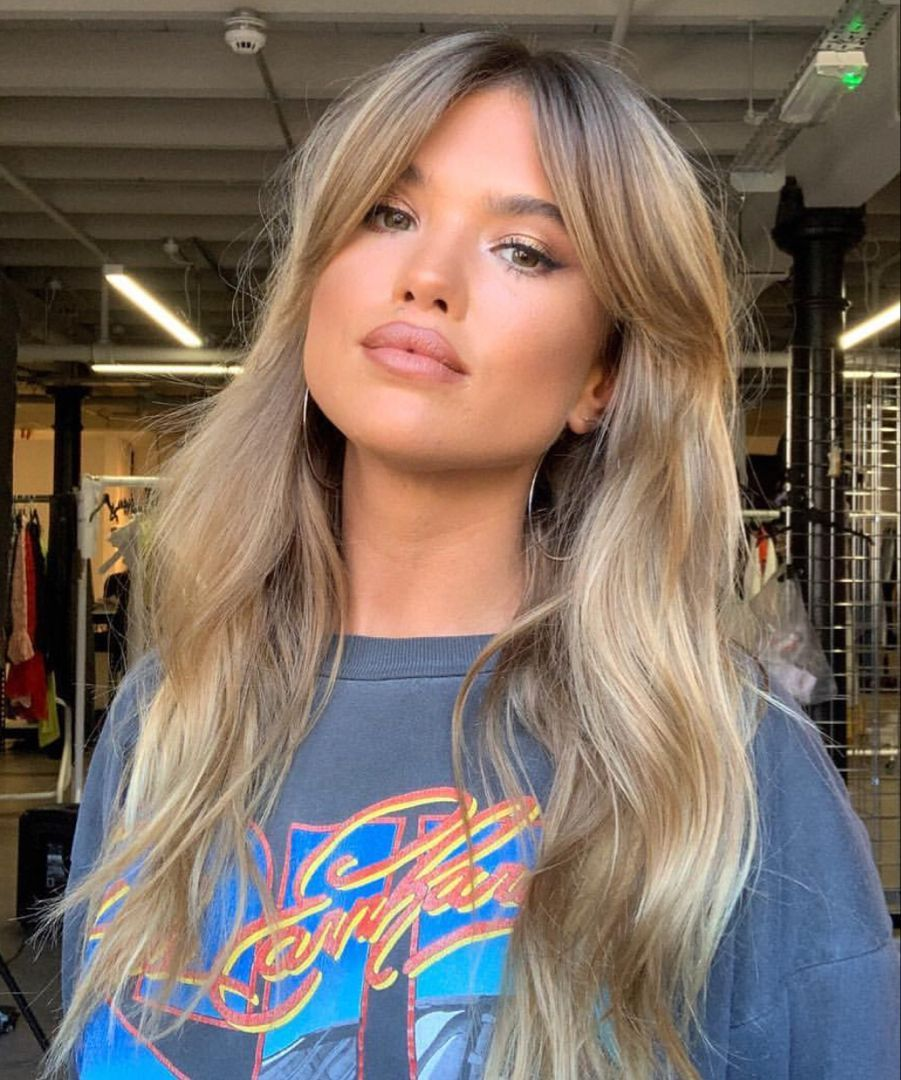 Photo of gorgeous Matilda djerf curtain bangs hair style with waves and blonde hair color…