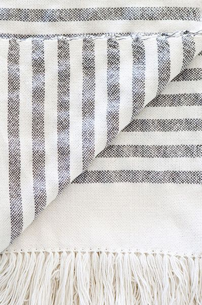 The Sailor throw with blue and white stripes.