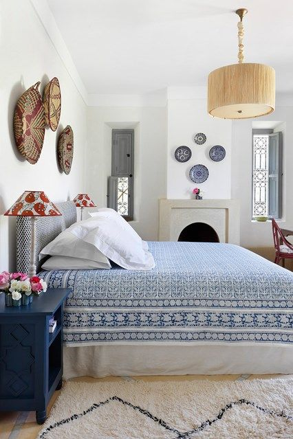 A Blue And White Moroccan Bedroom With Pretty Delft Palette An Indian Cotton Bedspread Ceramic Plates Above The Chimneypiece From Fez