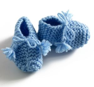Simple Garter Stitch Booties  My mother will soon be a great-grandmother. I'm excited to make these easy baby booties.