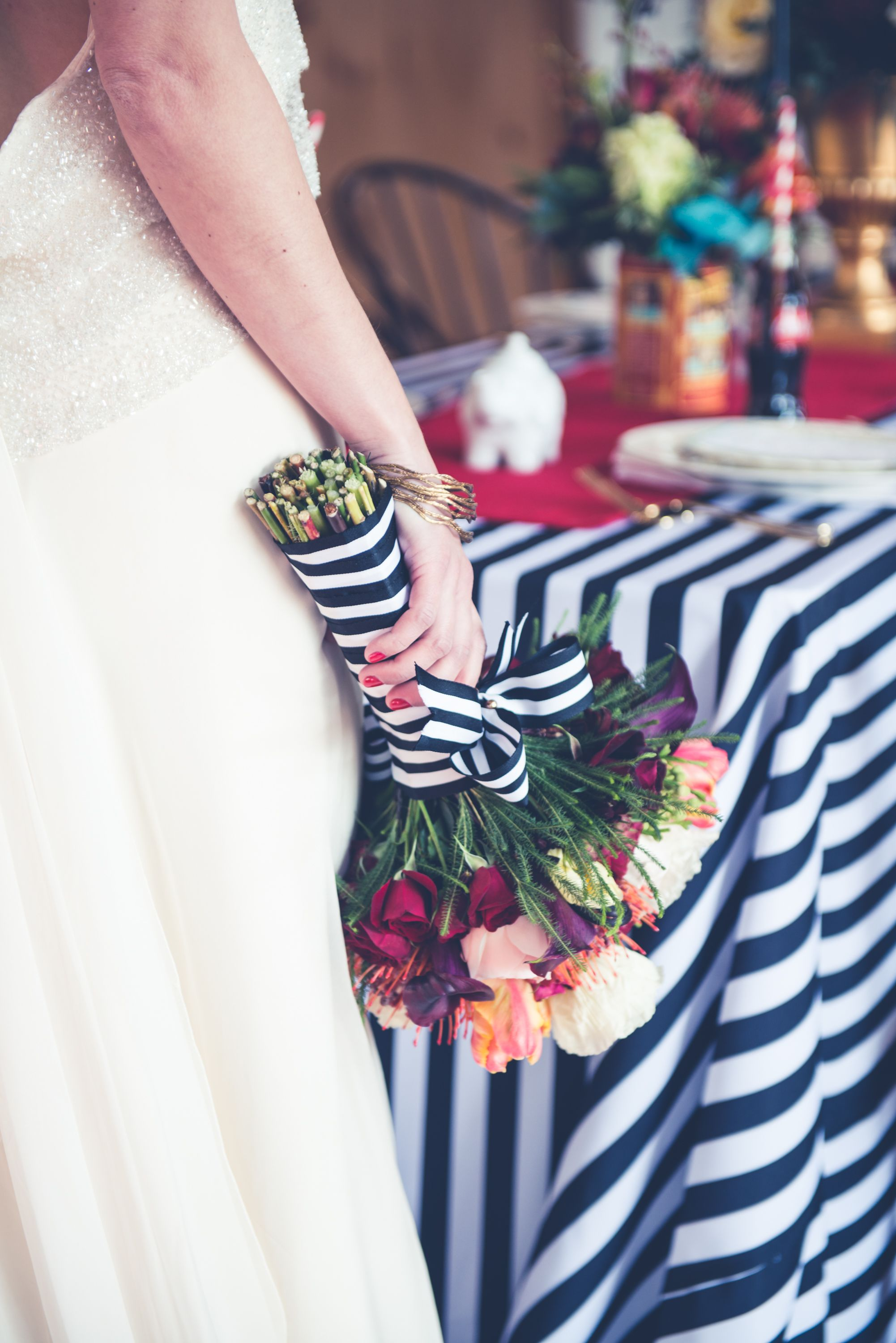 """Bride's bouquet wrap """"borrowed"""" from """"Stripe Black and White"""" tablecloth from Gala Cloths."""