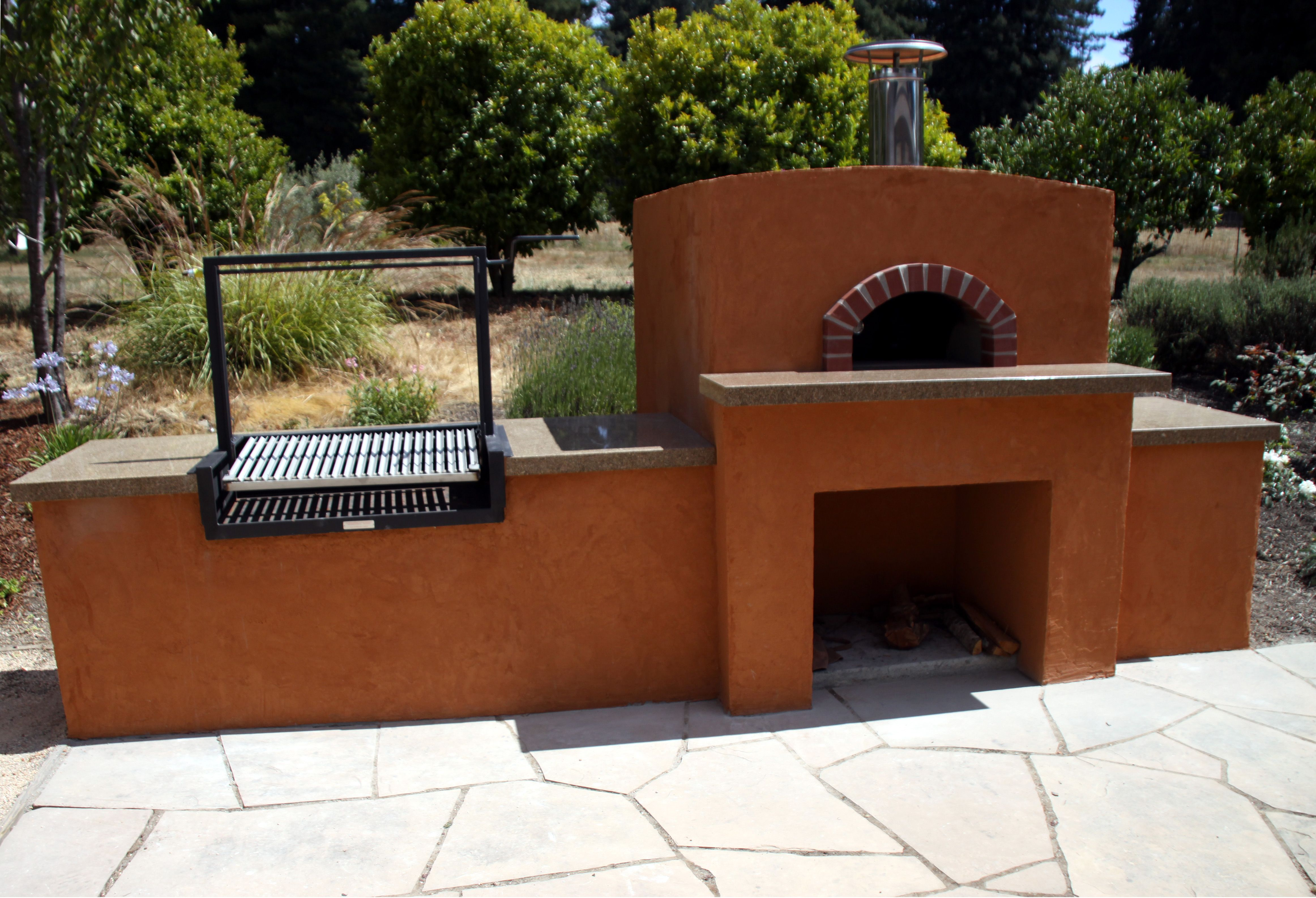 No gas here charcoal bbq and wood fired pizza oven built into