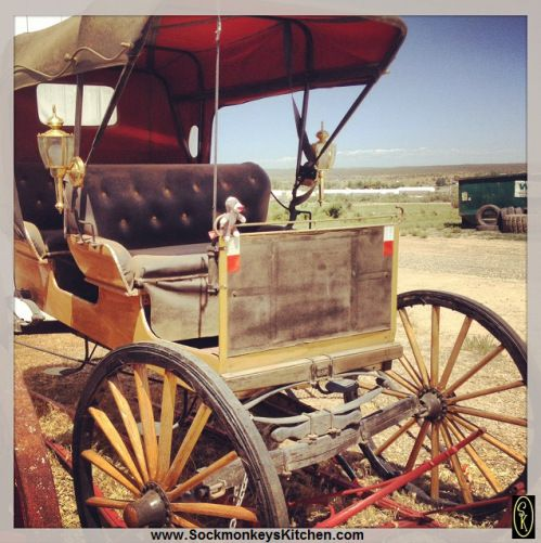 It's an antique carriage... with a #monkey. Click the pic for all of the #Sockmonkey photos