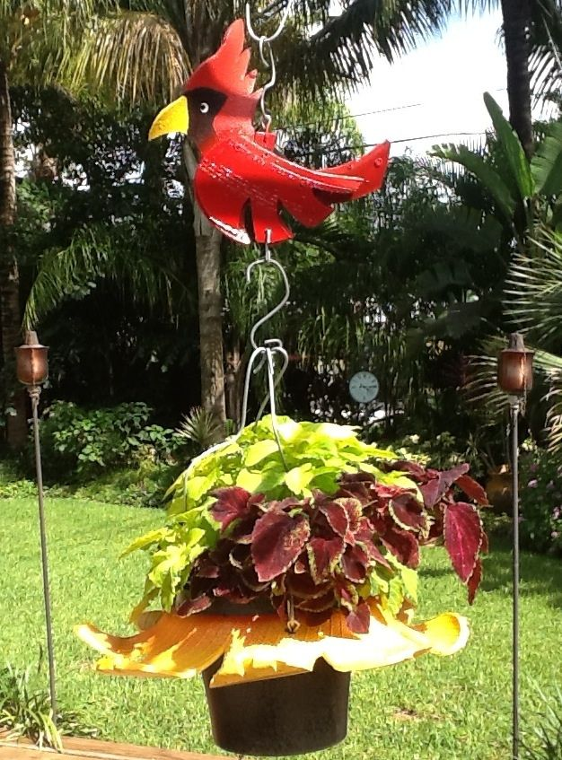 Recycled Tire Sunflower Planter with a red cardinal recycled tire bird from www.cooltireswings.com