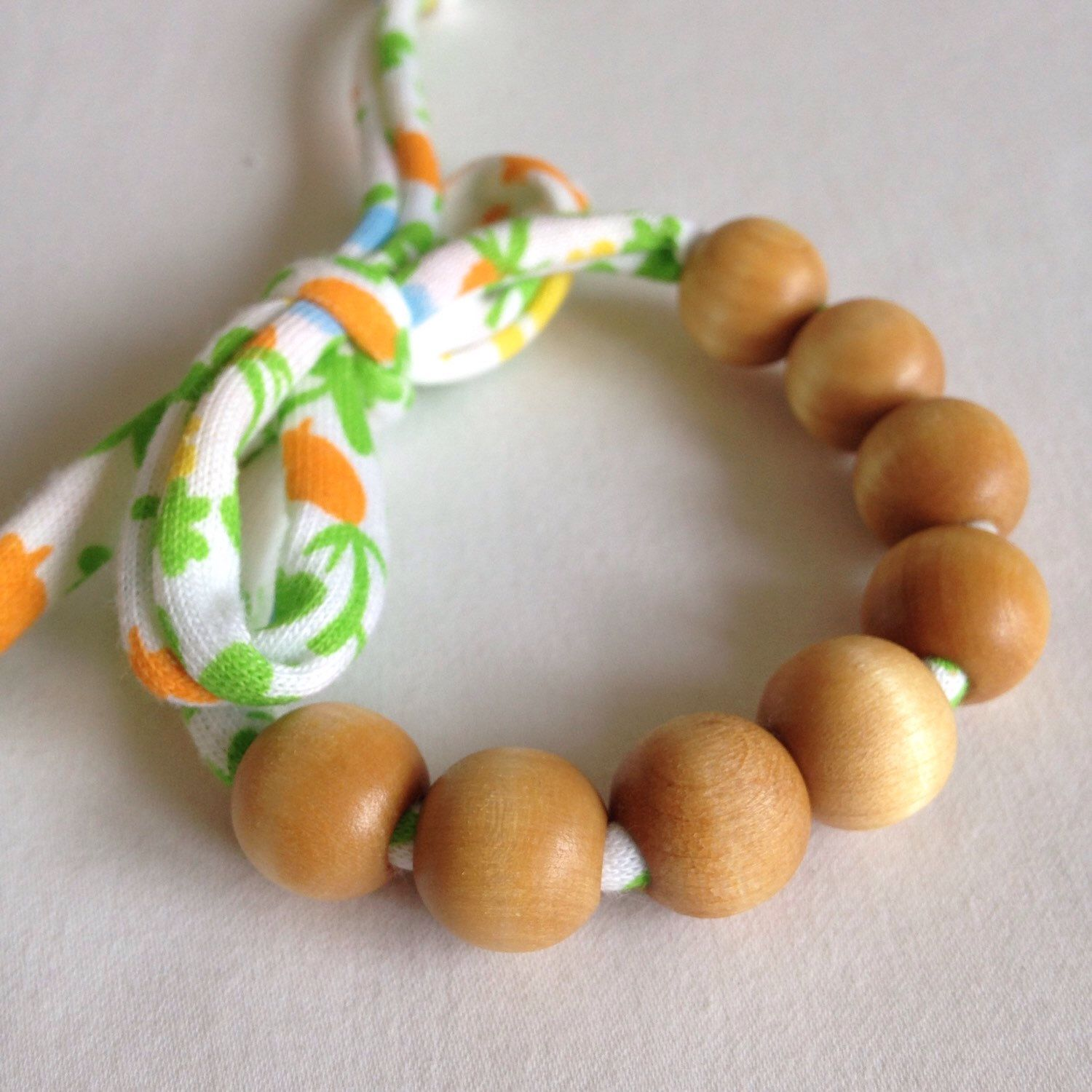 A personal favorite from my Etsy shop https://www.etsy.com/listing/209154213/natural-wood-bead-12mm-womens-bracelet