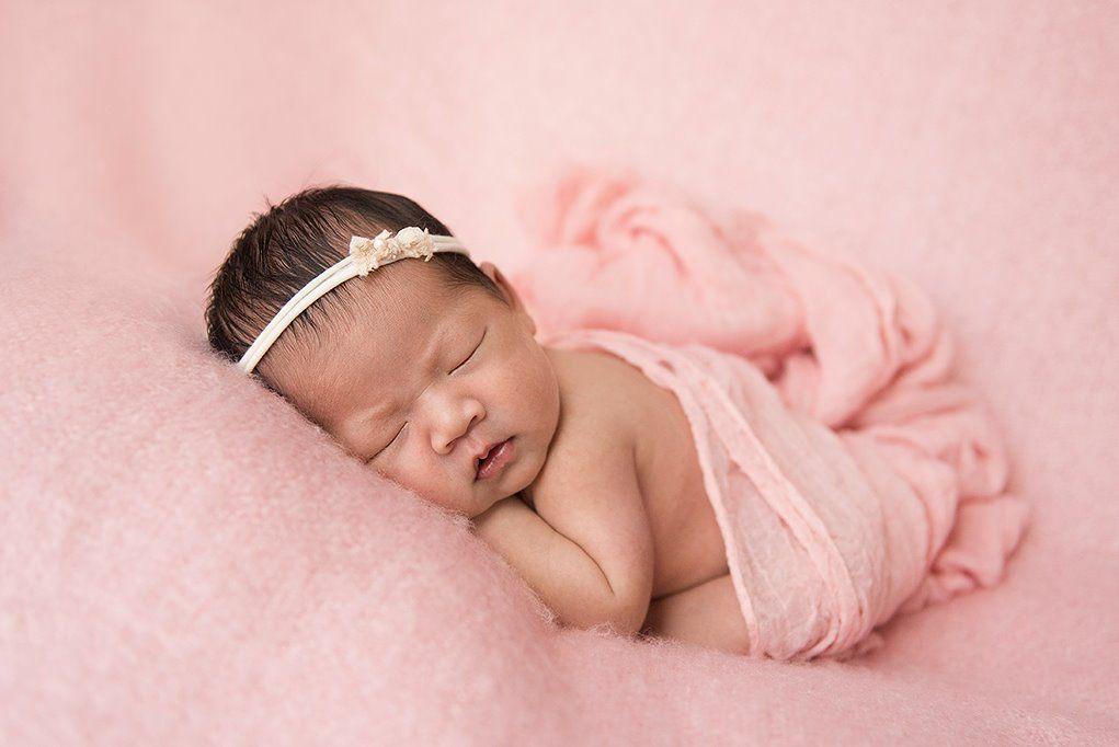 Gallery of custom in home newborn photo sessions by boston lifestyle newborn photographer beth miga