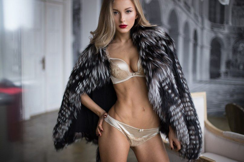 Sexy young girl in coat and lingerie