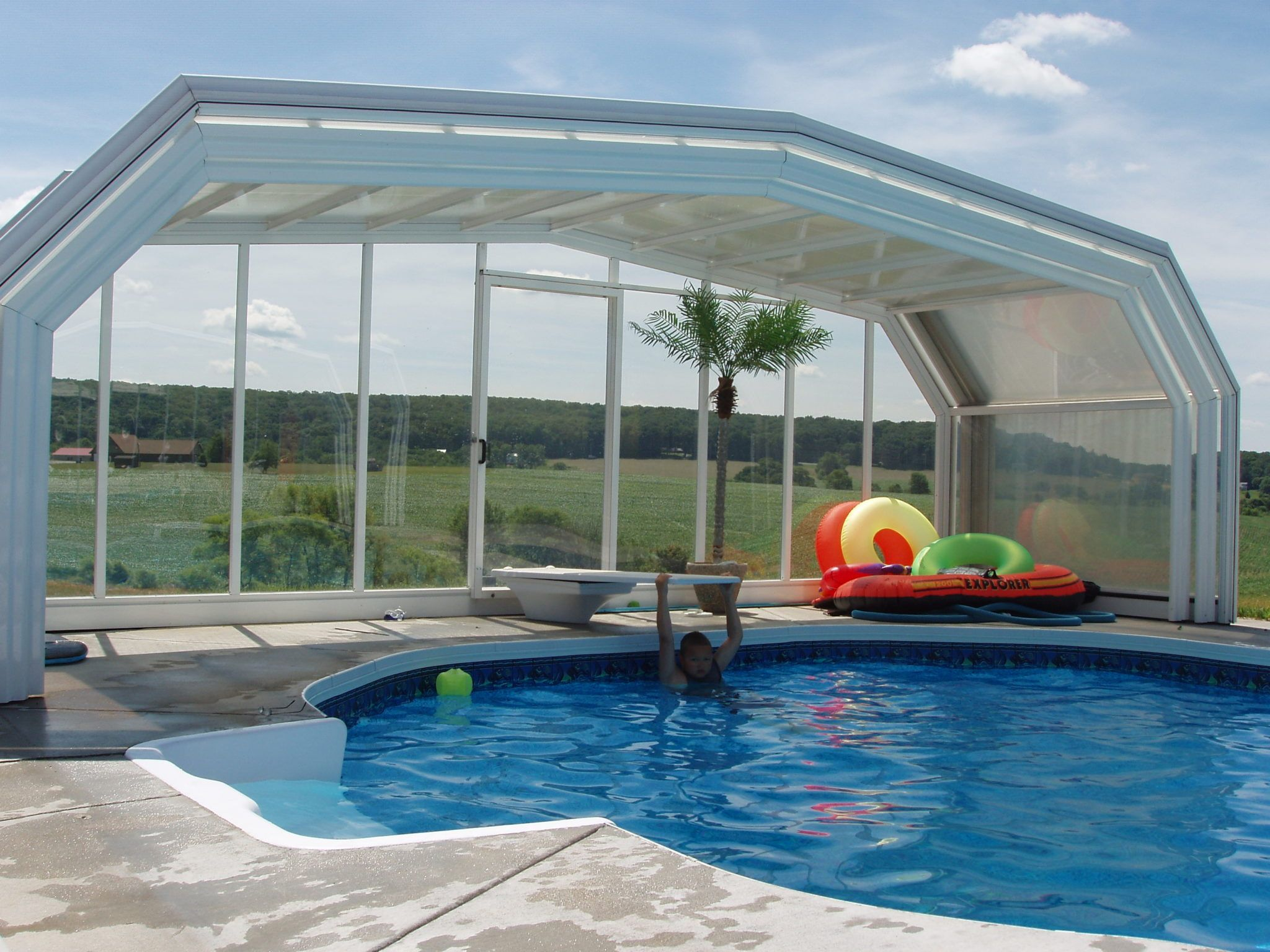 All Seasons Sunrooms Of Connecticut Manufactured By Roll A Cover In 2020 Swimming Pool Enclosures Pool Enclosures Outdoor Swim Spa