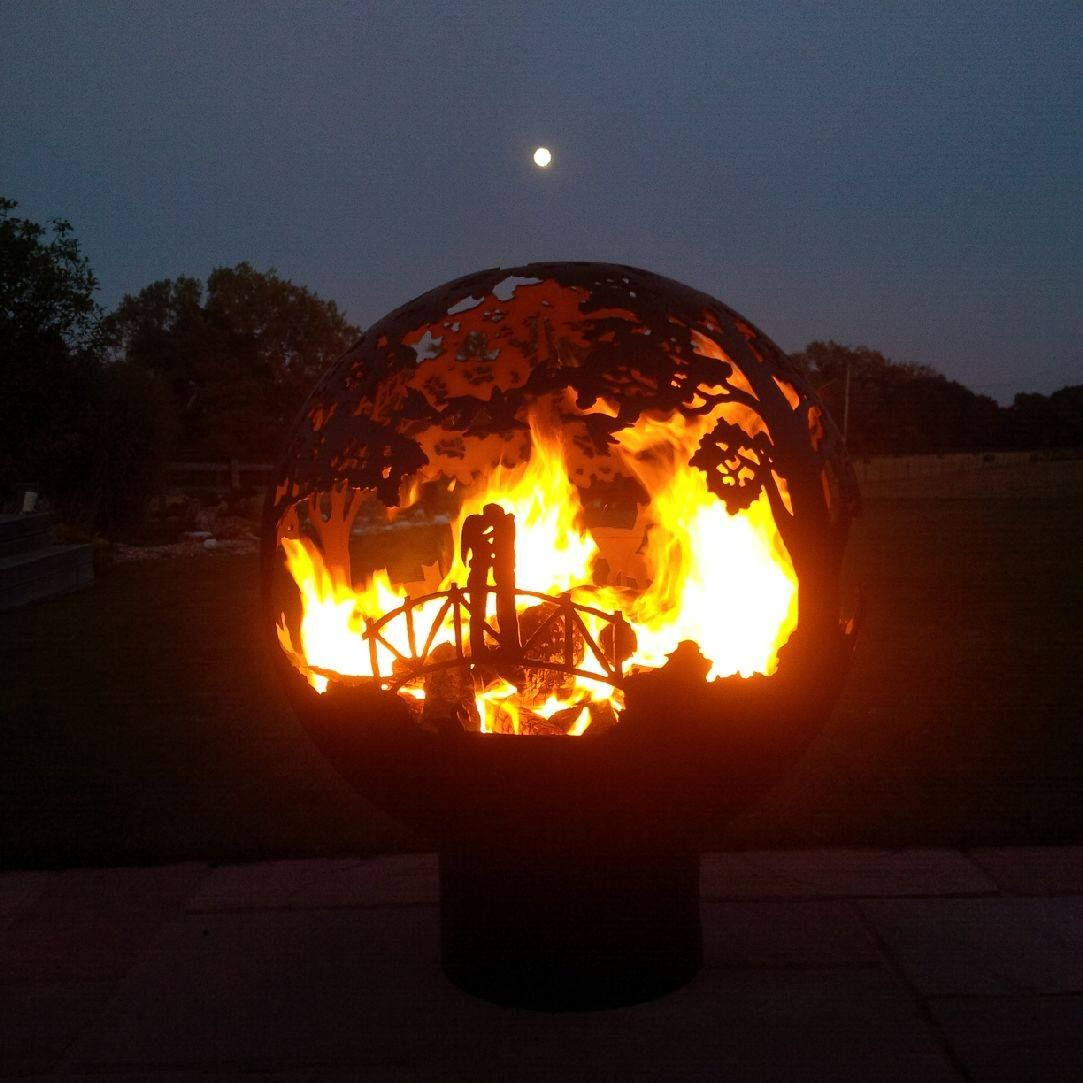 The Warmth Of A Fire Pit Continues The Cosy Atmosphere Outside