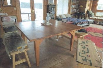 Small dining table - this one has four benches, but chairs can be substituted if you'd like. Check out the design of the legs!