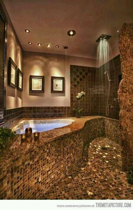 This spa inspired bathroom brings me back to the Mineral Resort up north I used to frequent with my mom and sister. Soothing browns and creams to mimic a rock cave with a rainfall shower and bubbling hot tub. Light me some candles and leave me be in this peaceful place...