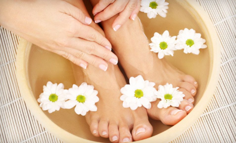 Groupon - One or Two Deluxe Mani-Pedis or One Hot-Stone Mani-Pedi at ...