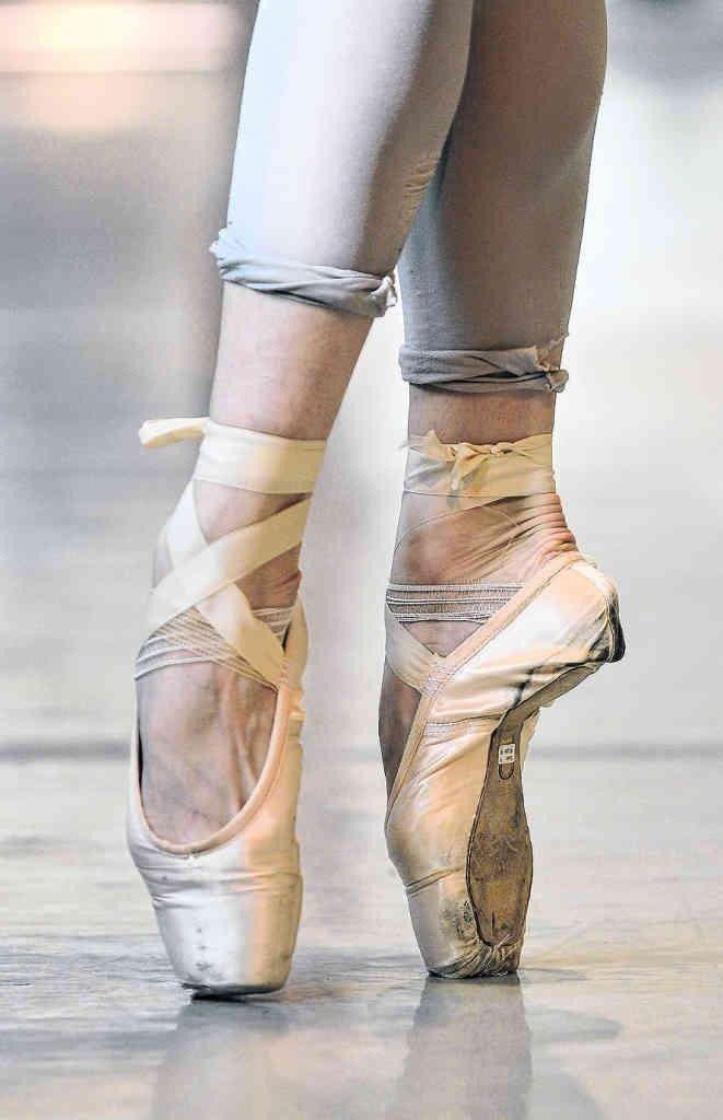 Share ballerina giving ballet slipper footjob