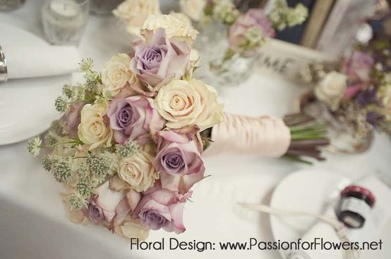 Ivory and pale lavender roses. So sweet. Vintage colors