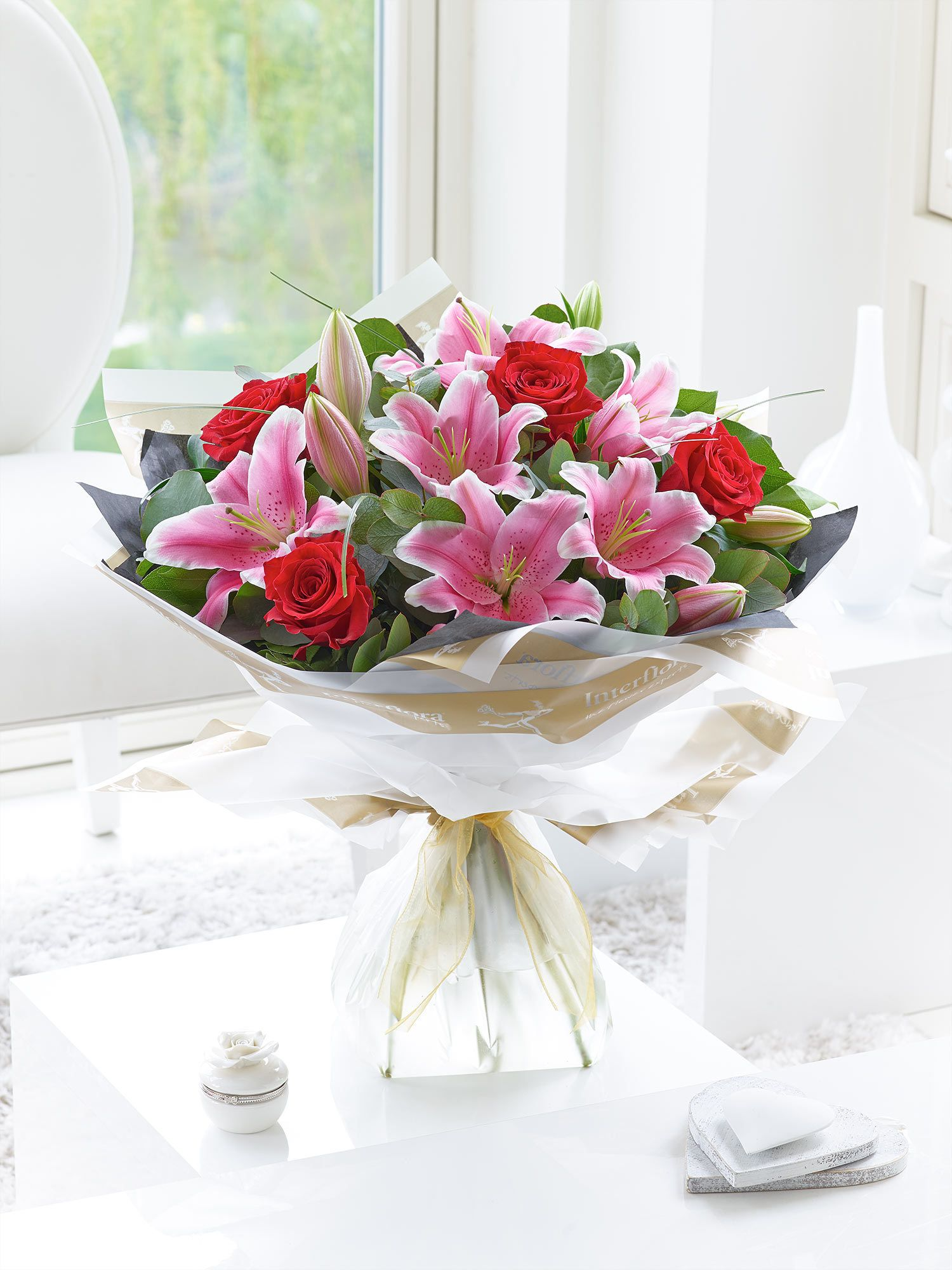 Roses and lilies are always a favourite combination, and