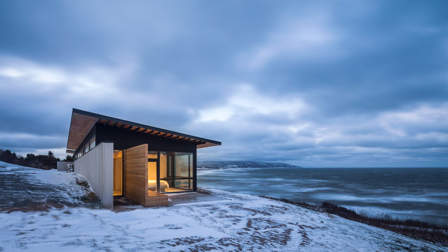 Omar Gandhi Architect perches glass-walled cabin on rocky cliff in ...