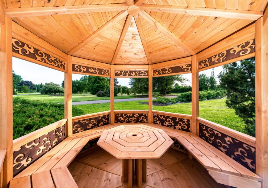 This Pine Wood Gazebo Has Built In Benches And A Table In The