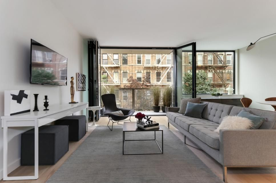 modern white condo in new york city living spaces hgtv and grey
