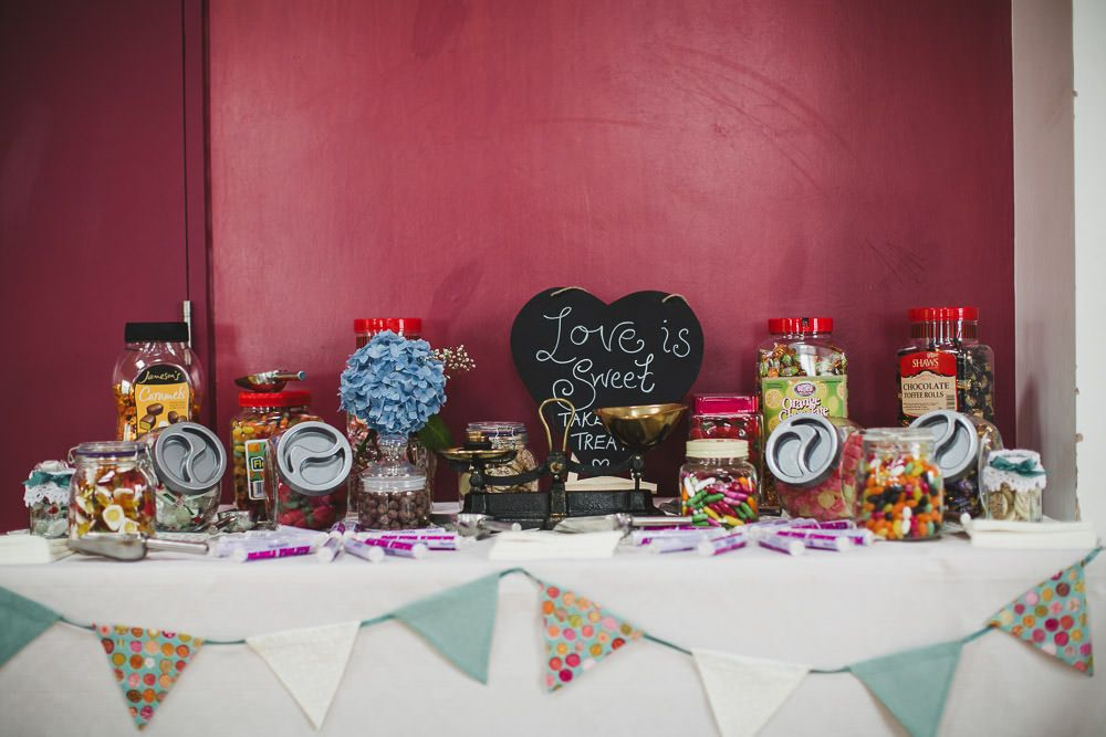 Sweet table with vintage bunting -   A vintage inspired wedding in Northern Ireland with lace wedding dress, pink and green colour scheme and photographs by Connor McCullough wedding photographer