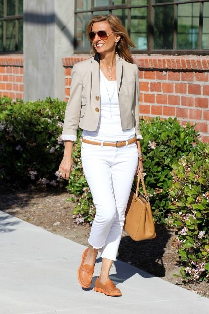 White jeans with a slim, camel-colored leather belt, a white V ...