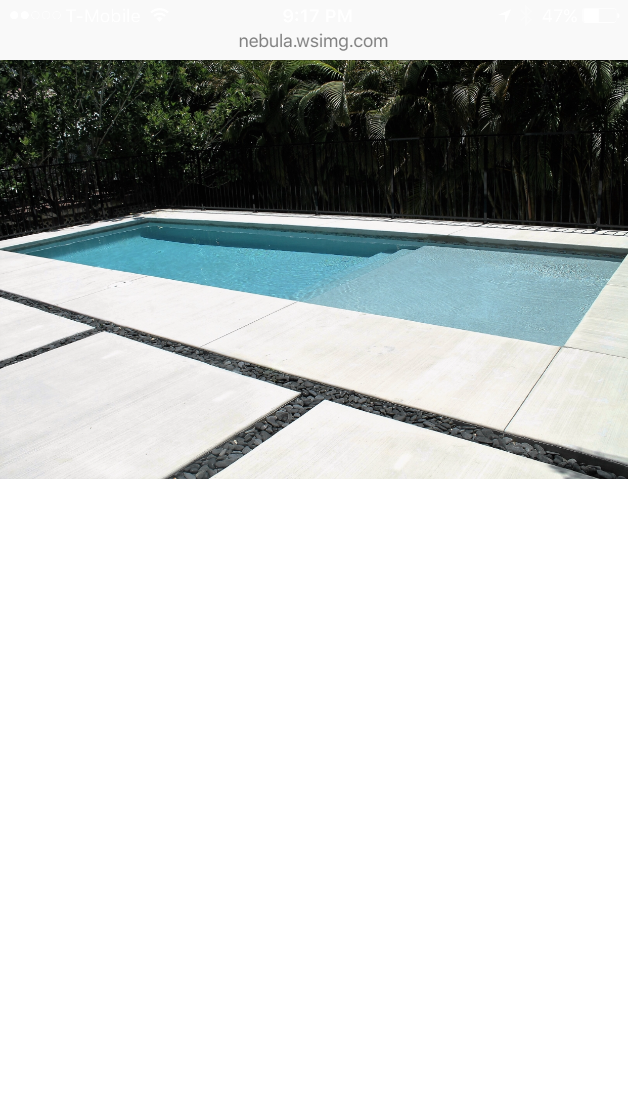 Pool surround with concrete & black river rock | Home: Pool Area ...